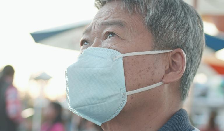 Asian elder man wears mask