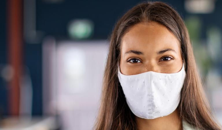Portrait of a businesswoman with face mask in office