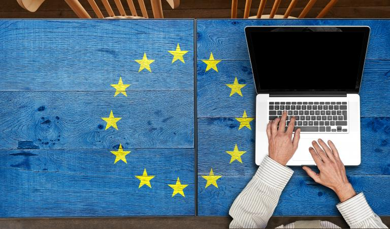 Europe flagged wooden table with laptop