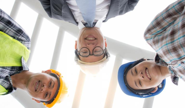 Professional Asian engineering team wearing safety helmet. Photo: iStockphoto